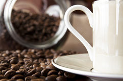 Coffee background. Cup of coffee and roasted coffee grain Royalty Free Stock Photos