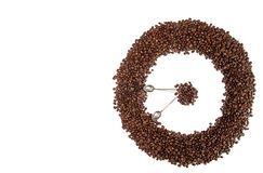 Coffee background. Heap coffee beans in shape of circle clock Stock Images