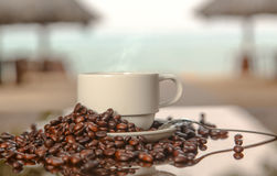 Coffee on the background of the sea. Cup of coffee on the beach stock photography