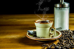 Coffee background sugar and beans. Coffee beans on a wooden table, a cup of espresso coffee and white sugar Royalty Free Stock Photography