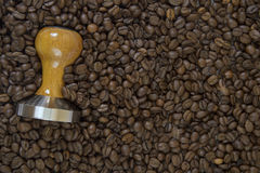 Coffee background with tamper close up Royalty Free Stock Photo