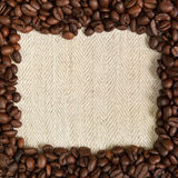 Coffee. Background texture of linen fabric and frame of coffee beans Stock Photos
