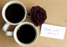 Coffee background. Two cups of black coffee on eco backdrop Royalty Free Stock Photo