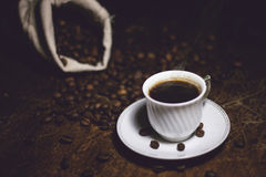 Coffee. And a bag filled with coffee cup on the table Royalty Free Stock Photo