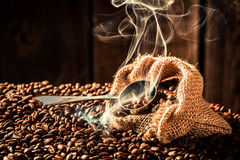 Coffee bag full of aroma seeds stock images