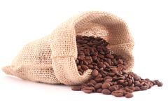 Coffee bag and lots grains of coffee. Grains of coffee and coffee canvas bag isolated on white Royalty Free Stock Photos
