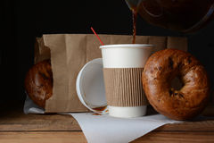 Coffee and Bagel Breakfast To-Go royalty free stock photography
