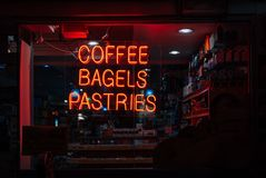 Coffee Bagels Pastries neon sign in the East Village, New York City.  stock image