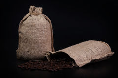 Coffee bags, burlap, with coffee beans. Royalty Free Stock Photos