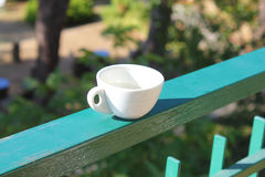 Coffee on the balcony. A coffee cup on the balcony Royalty Free Stock Photo