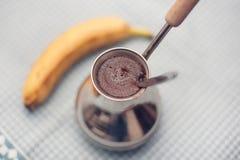 Coffee and banana Royalty Free Stock Photography
