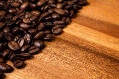 Coffee bans on wood board Stock Photo