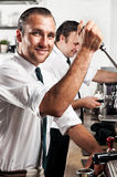 Coffee barista at work royalty free stock image