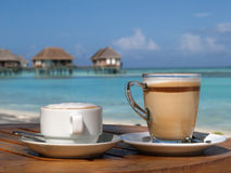 Coffee on beach in sunny day Royalty Free Stock Photos