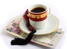 Coffee beads and cash Stock Images