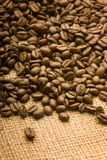 Coffee bean. Roasted coffee beans selected on rustic cloth bag Stock Photos