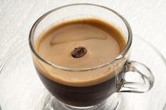 Coffee bean. In cream coffee cup Stock Image
