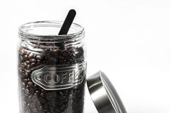 Coffee bean. S in an open glass jar royalty free stock photo