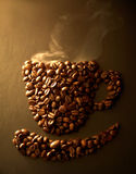Coffee bean. Arrangement of coffee beans into shape of cup