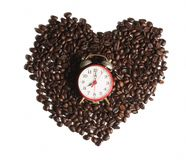 Coffee bean with alarm clock. Coffee bean in heart shape with alarm clock Royalty Free Stock Photography