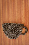 Coffee bean as a cup on wooden table Stock Images