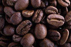 Coffee bean background. Full frame close-up of aromatic fresh roasted coffee beans Royalty Free Stock Photo