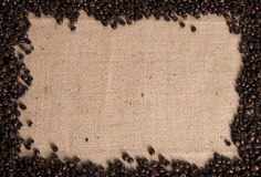Coffee bean background. Coffee beans creating a border on a hessian coffee sack Stock Photos