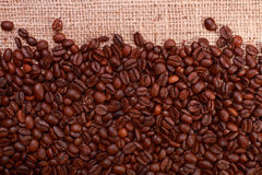 Coffee bean background with burlap showing Royalty Free Stock Image