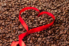 Coffee bean background with heart shape ribbon Royalty Free Stock Images