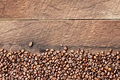 Coffee Bean Background over Wood Table Top Stock Images