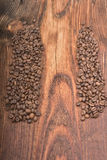 Coffee bean background on wood. En texture Stock Photos