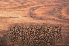 Coffee bean background on wood. En texture Royalty Free Stock Photos
