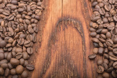 Coffee bean background on wood. En texture Royalty Free Stock Photo