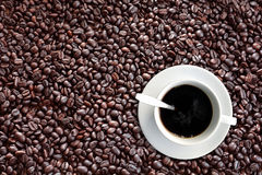 Coffee bean. S background with roasted natural seeds,white cup Royalty Free Stock Photos