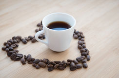 Coffee bean and black coffee inside a heart Stock Image
