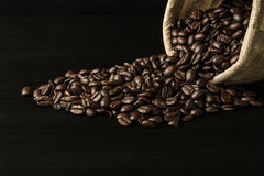 Coffee bean on black wood background Stock Photos