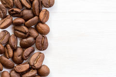 Coffee bean border on wood surface Stock Images