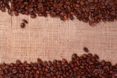Coffee bean borders on hessian background Stock Images