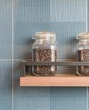 Coffee bean in bottle. On shelf Royalty Free Stock Photo