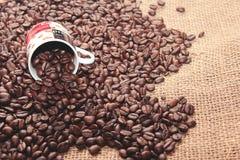 Coffee bean on burlap. Stock Photos