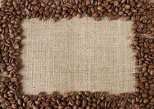 Coffee bean on burlap frame. Frame from fried coffee bean on burlap Royalty Free Stock Photo