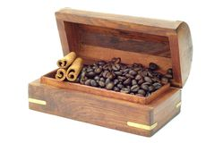 Coffee Bean in a Chest Box on white background. Coffee Bean in a Chest Box accompanied with Cinnamon stick Stock Photos