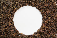 Coffee bean circle. White circle within brown roasted coffee beans Stock Image