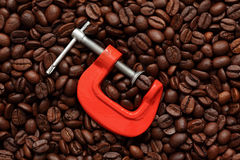 Coffee bean in a clamp Stock Image