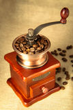 Coffee bean and coffee bean grinder Royalty Free Stock Image