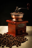 Coffee bean and coffee bean grinder Stock Images