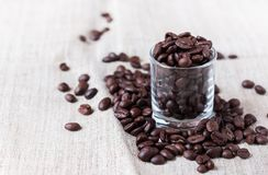Coffee bean. S in a little glass on sack Stock Image