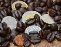 Coffee bean and coin Stock Photos