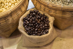 A coffee bean in a container with both roasted and raw. Represent a fresh and scent of coffee. Royalty Free Stock Photos
