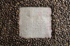 Coffee bean cube. White cube within brown roasted coffee beans Stock Image